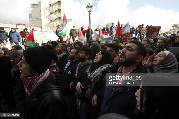 Palestinian protesters shout slogans as the convoy of Jerusalem's Greek Orthodox patriarch Theophilos III arrives in the West Bank town of Bethlehem...
