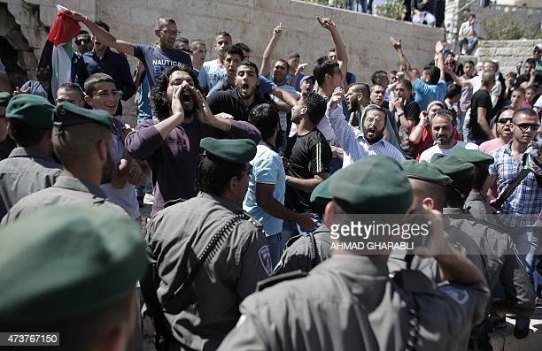 Palestinian protesters shout slogans in front of Israeli security forces outside Damascus Gate in Jerusalem's old city on May 17 as Israeli...