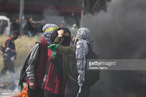Palestinian protesters stage a protest organized to mark 70th anniversary of Nakba also known as Day of the Catastrophe in 1948 and against United...