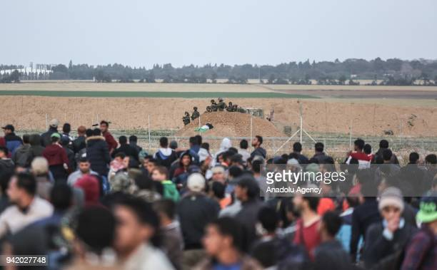 Palestinian protesters take part in a demonstration demanding the right of return and removal of the blockade following the 'Great March of Return'...