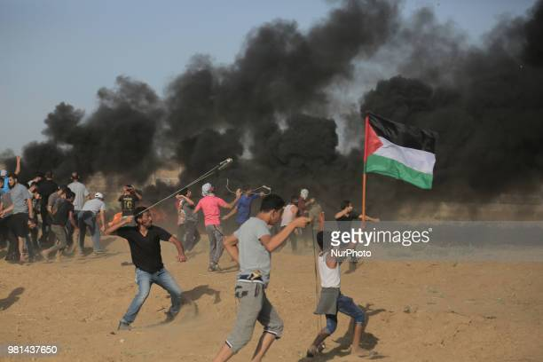 Palestinian medics carry a wounded woman during clashes with Israeli troops on the GazaIsrael border east of Gaza city on June 22 2018