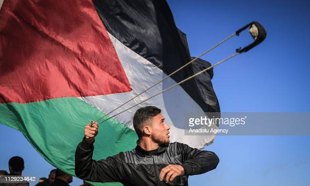 Palestinian protesters throw stones in response to Israeli forces' intervention during Great March of Return demonstration near IsraelGaza border in...