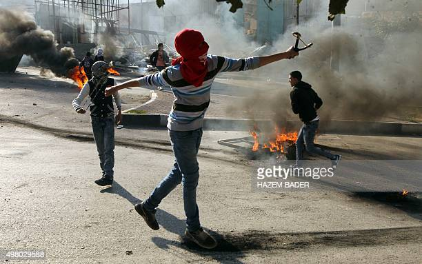 Palestinian protesters throw stones towards Israeli security forces during clashes following the funeral of 26yearold Palestinian Shadi Arafa on...