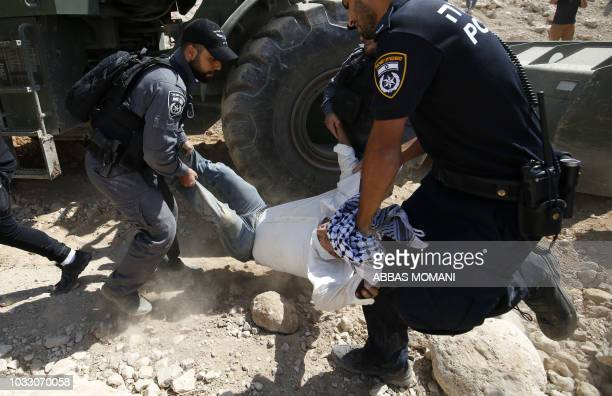 Palestinian protestor confronts Israeli forces on September 14 as he demonstrates against the blocking of the road leading to the Palestinian Bedouin...