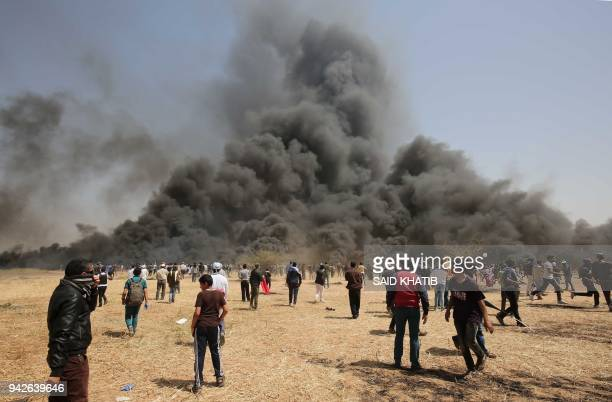 Palestinian protestors burn tyres during clashes with Israeli security forces during clashes on the GazaIsrael border following a protest east of...