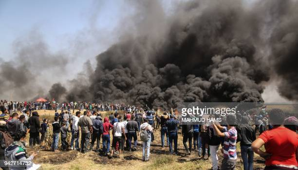 Palestinian protestors burn tyres during clashes with Israeli security forces on the GazaIsrael border following a protest calling for the right to...