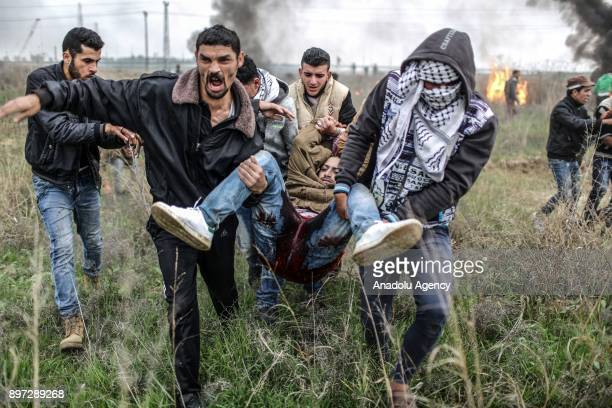 Palestinian protestors carry wounded protester Nebii Muhaysin during a demonstration against US President Donald Trump's recognition of Jerusalem as...