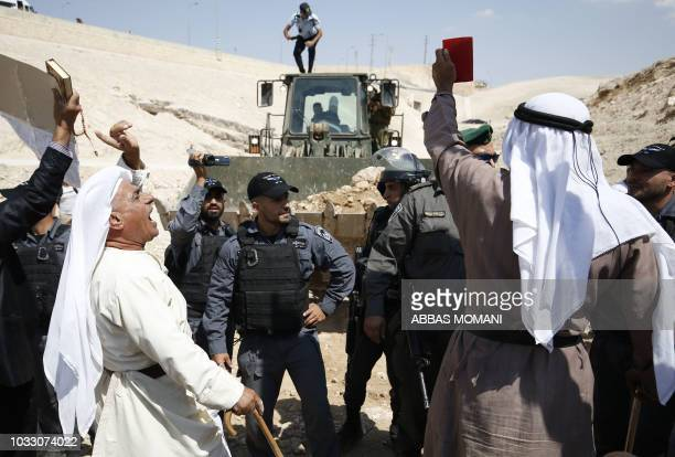 TOPSHOT Palestinian protestors chant slogans and confront Israeli forces on September 14 as they demonstrate against the blocking of the road leading...