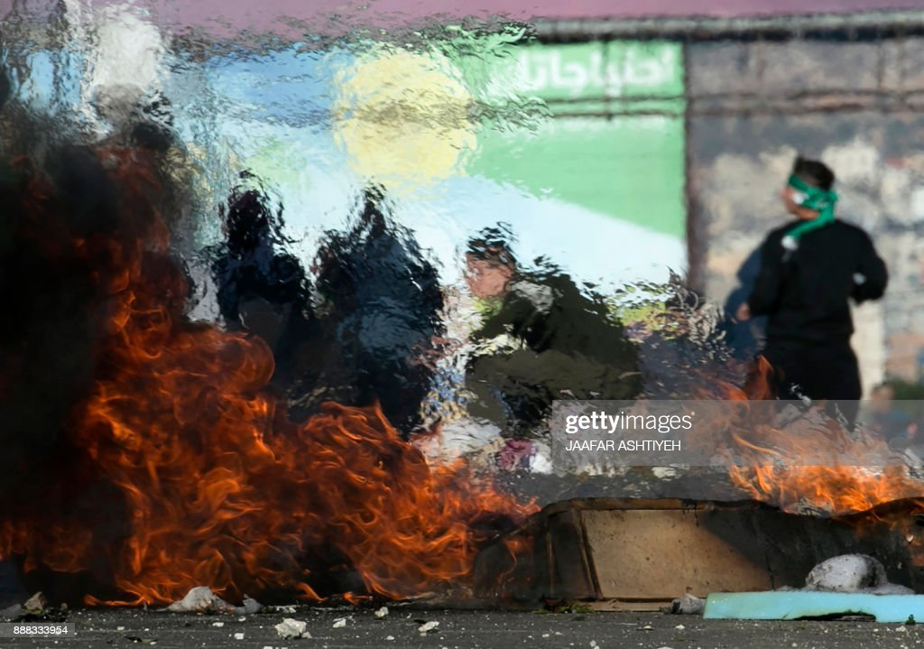 Palestinian protestors clash with Israeli security forces at Hawara checkpoint, south of the West Bank city of Nablus, following a demonstration against US President Donald Trump's decision to recognise Jerusalem as the capital of Israel on December 8, 2017. Palestinians clashed with Israeli security forces after calls for a 'day of rage' as US President Donald Trump's declaration of Jerusalem as Israel's capital sent shockwaves through the region for a second day. /