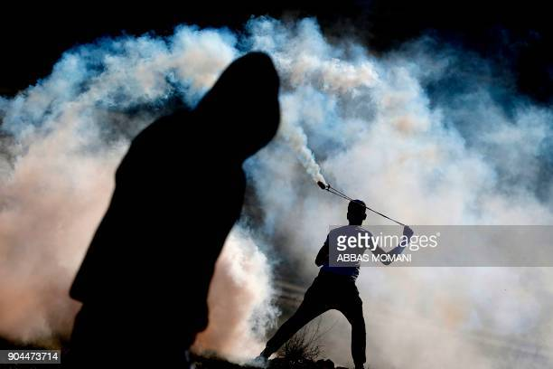 Palestinian protestors clash with Israeli security forces following a demonstration calling for the release of Palestinian prisoners from Israeli...