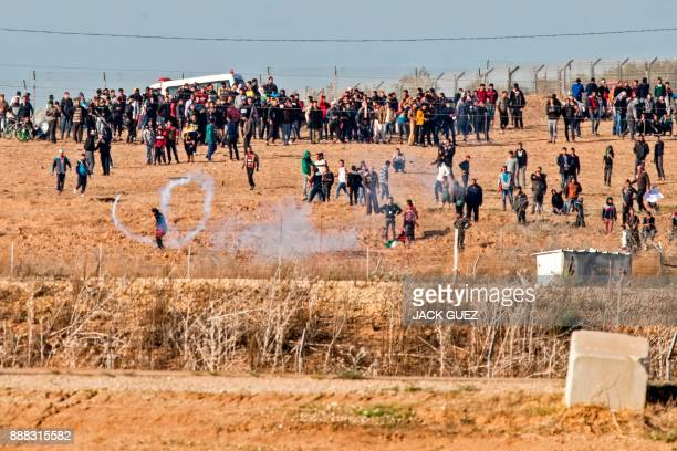 TOPSHOT Palestinian protestors clashes with Israeli soldiers along the IsraelGaza border on December 8 2017 Palestinians clashed with Israeli...