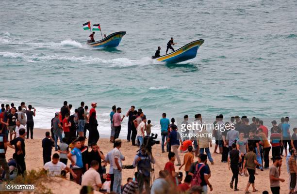 Palestinian protestors gather on the beach and on boats near the maritime border with Israel in the northern Gaza Strip on October 1 2018 The border...