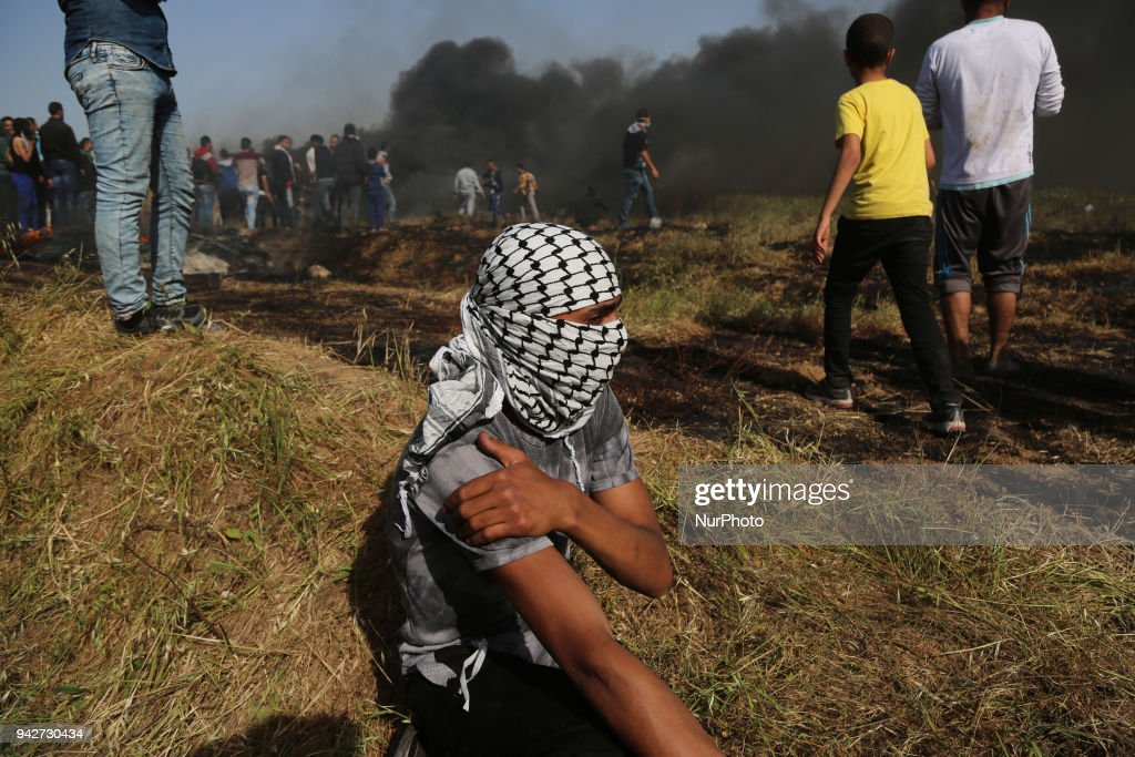 Palestinian protestors gesture during clashes with Israeli security forces on the Gaza-Israel border following a protest calling for the right to return, east of Gaza City on April 6, 2018. Clashes erupted on the Gaza-Israel border a week after similar demonstrations led to violence in which Israeli force killed 19 Palestinians, the bloodiest day since a 2014 war.