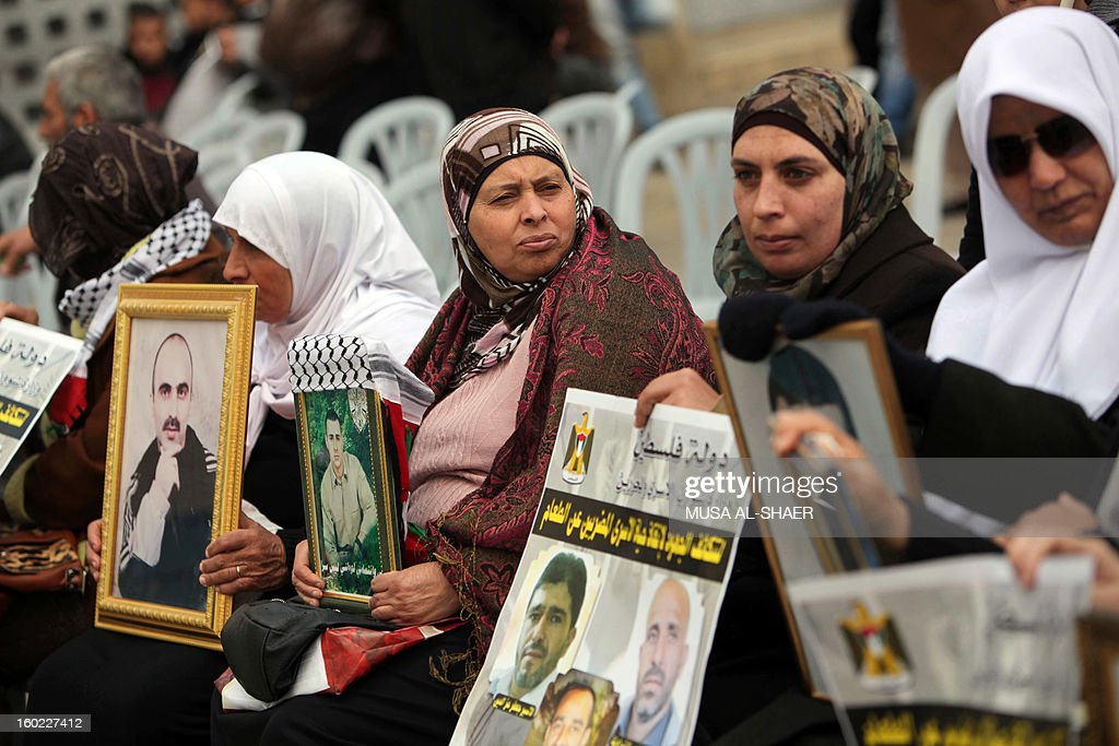 Palestinian protestors hold pictures of detained relatives during a demonstration in support of Palestinians on a hunger strike in Israeli jails, in front of the Church of the Nativity at the West Bank city of Bethlehem on January 28, 2013.