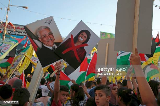 Palestinian protestors hold portraits of Palestinian president Mahmud Abbas and US Ambassador to the United Nations Nikki Haley during a rally in...