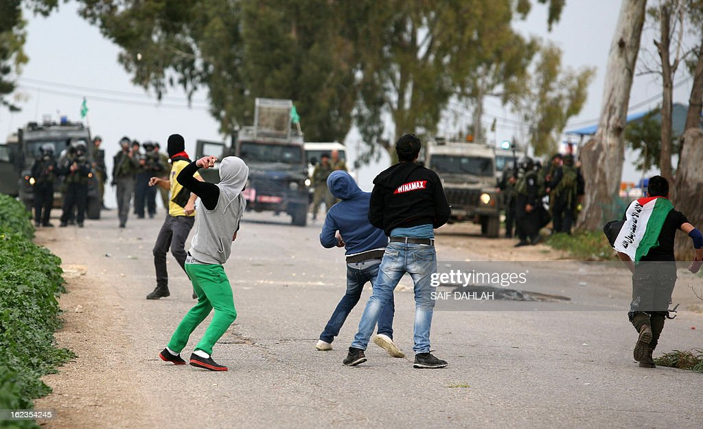 Palestinian protestors hurl stones at Israeli police during clashes at the entrance of the Jalama checkpoint, near the West Bank city of Jenin, on February 22, 2013. Palestinians demanding the release of hunger-striking prisoners clashed with Israelis in the West Bank and east Jerusalem, as three fasting inmates were taken to hospitals.