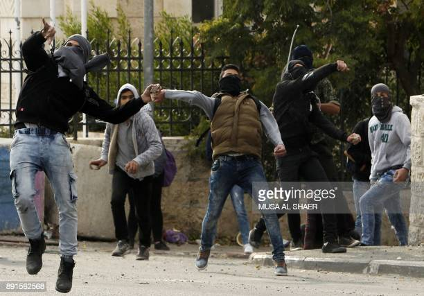 Palestinian protestors throw stones towards Israeli forces during clashes following a demonstration in the occupied West Bank city of Bethlehem on...