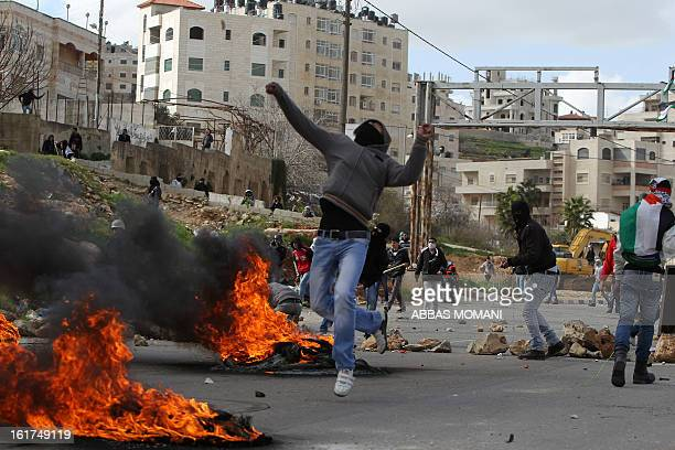Palestinian protestors throw stones towards Israeli security forces during clashes in front of Ofer prison, near the West Bank city of Ramallah,...