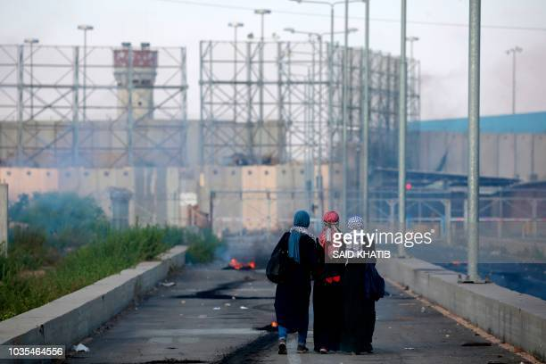 TOPSHOT Palestinian protestors walk towards the border during a demonstration at the Erez crossing with Israel on September 18 in the northern Gaza...