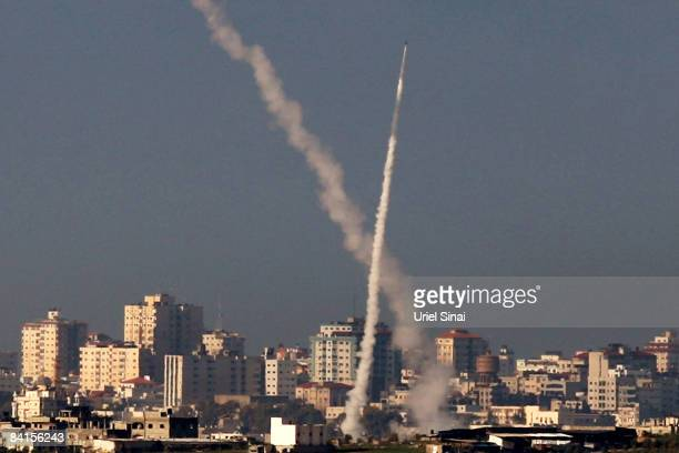 Palestinian Qassam rockets are seen as they are launched from Hamascontrolled Gaza on January 02 2009 Israel continues to reinforce its troops amid...