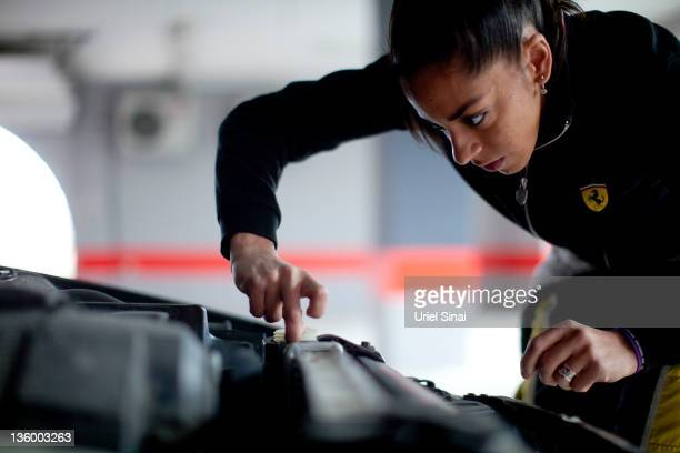 Palestinian racing driver Noor Daoud maintains her car on December 8 2011 in Ramallah West Bank Daoud will compete in Israel's first legal car race a...