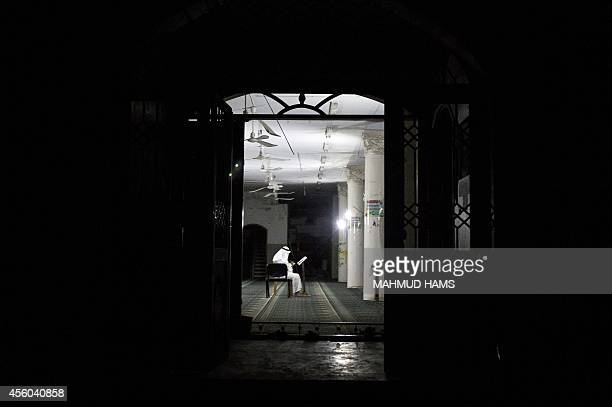 A Palestinian reads the Koran Islam's holy book at a mosque in the Shejaiya neighborhood of Gaza City on September 24 2014 A new UNbrokered deal has...