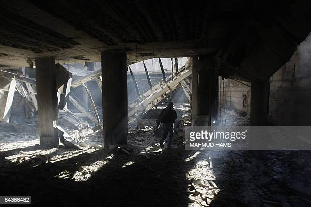 A Palestinian Red Crescent staff inspects the bombed alQuds hospital in the southern Gaza City on January 21 2009 Israeli fire destroyed part of the...