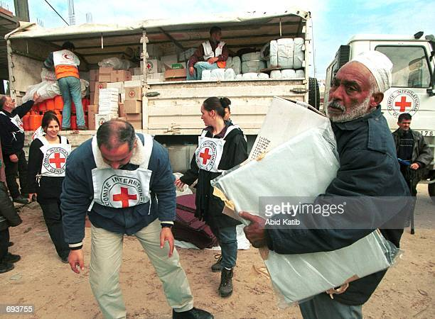 Palestinian refugee Abdelgalel Al Qasas holds blankets and housing supplies in Rafah south of the Gaza Strip January 13 2002 supplied by the...