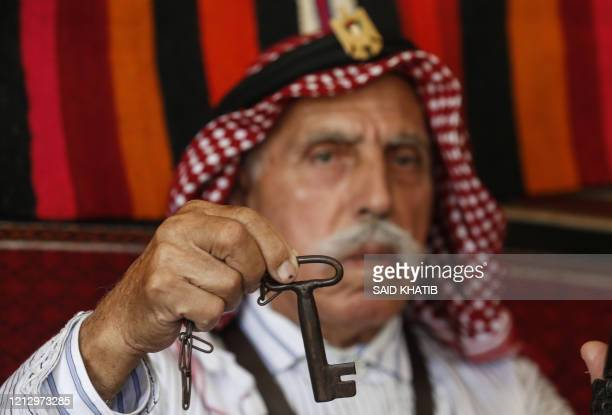 Palestinian refugee Mahmoud Abu Deeb a former fighter from Beersheba, holds a key at his home in Khan Yunis in the southern of Gaza strip, on May 14...