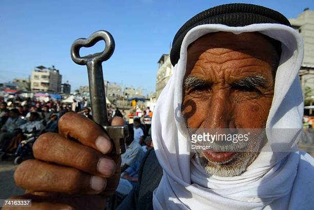 Palestinian refugee Mohamad Mahmoud AlArja from the Rafah refugee camp holds up a key allegedly from his house in Beer AIsaba now located in Israeli...