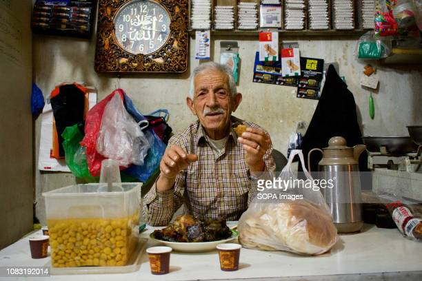 Palestinian refugee seen at his shop in the Dheisheh Refugee Camp