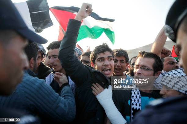 """Palestinian refugee shouts anti-Israel slogans as they clash with police during a demonstration to mark the 63rd anniversary of """"Nakba"""", Arabic for..."""
