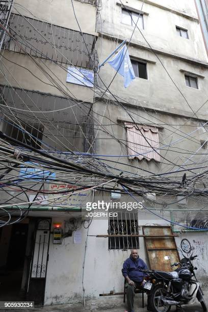 A Palestinian refugee sits at the entrance of the UNRWA offices in the Burj alBarajneh camp in the Lebanese capital Beirut on January 17 2018 The UN...