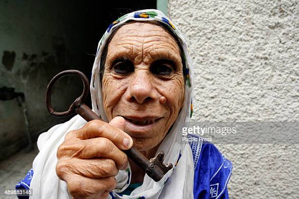Palestinian refugee, Subhia Abdul Rahim Abu Ghali, 79 years old, from the Rafah refugee camp, holds up a key allegedly from her house in Yebna...