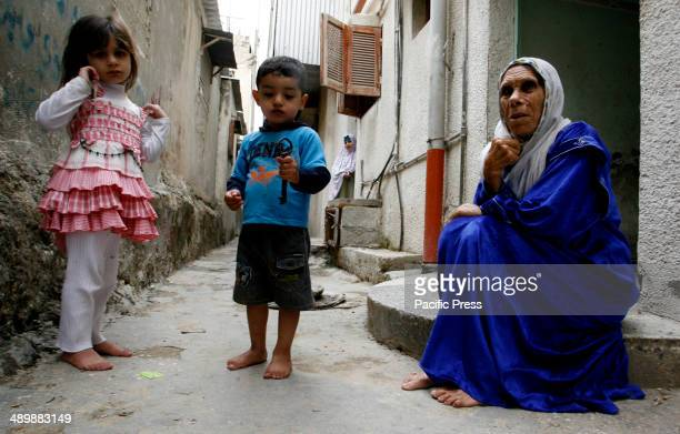 Palestinian refugee, Subhia Abdul Rahim Abu Ghali, 79 years old, from the Rafah refugee camp with her grandson who holds up a key allegedly from her...
