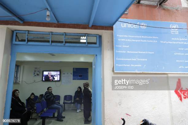 Palestinian refugees are seen at an UNRWA financed medical clinic at the Burj alBarajneh camp in the Lebanese capital Beirut on January 17 2018 The...