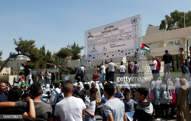 Palestinian refugees hold banners during a protest against the United Nations Relief and Works Agency for Palestine Refugees' decision on aid cuts...