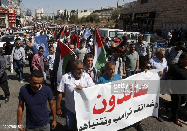 Palestinian refugees march during a protest against the United Nations Relief and Works Agency for Palestine Refugees' decision on aid cuts and...