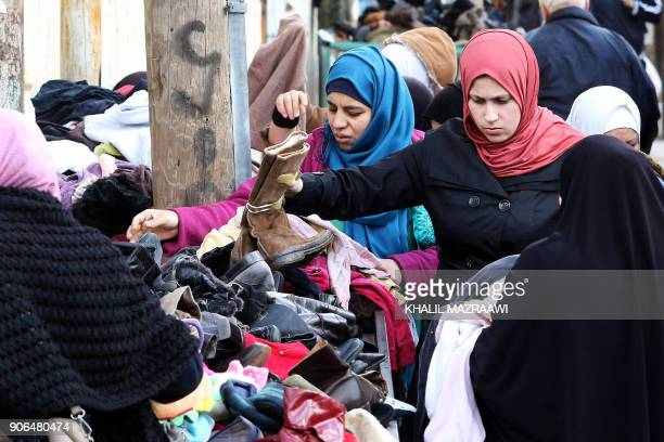 Palestinian refugees shop on January 18 2018 at the alBaqa'a refugee camp some 20 kilometres north of Amman which was built as an emergency camp in...