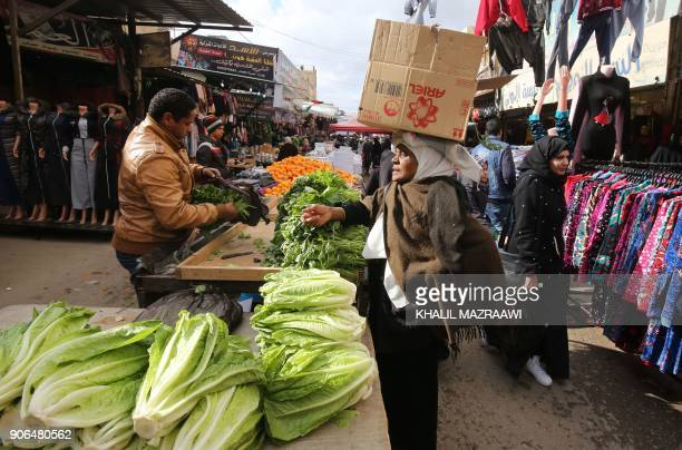TOPSHOT Palestinian refugees shop on January 18 2018 at the alBaqa'a refugee camp some 20 kilometres north of Amman which was built as an emergency...