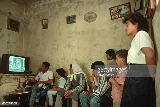 Palestinian Refugees Watching Television