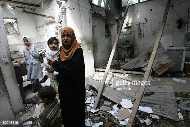 Palestinian relative of fivemonth old Mohammad Naser AlBuri stands amongst the damage at his family's home on February 28 2008 in Gaza City Gaza...