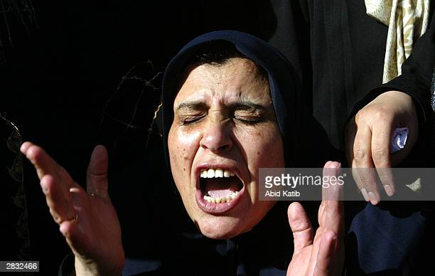 Palestinian relative of Islamic Jihad's top commander in the Gaza Strip Mekled Hameid cries during his funeral procession December 26, 2003 in the...
