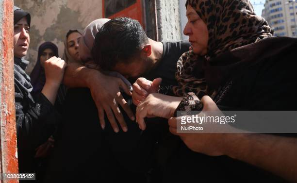 A Palestinian relative of Kareem Kullab who was killed at the IsraelGaza border fence mourns during his funeral in Gaza City September 22 2018