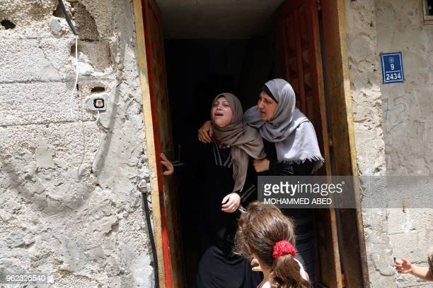 TOPSHOT Palestinian relatives of 23yearold Ahmed Qutoosh who died of his wounds endured during clashes with Israeli troops mourn during his funeral...