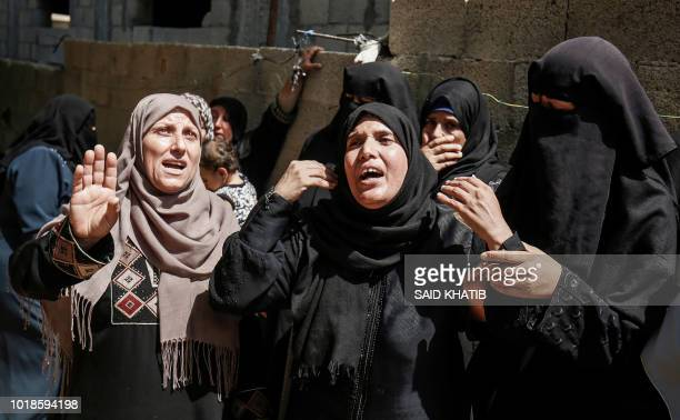 TOPSHOT Palestinian relatives of 26yearold Sadi Moamer who was killed the day before along demonstrations near the border with Israel mourn during...