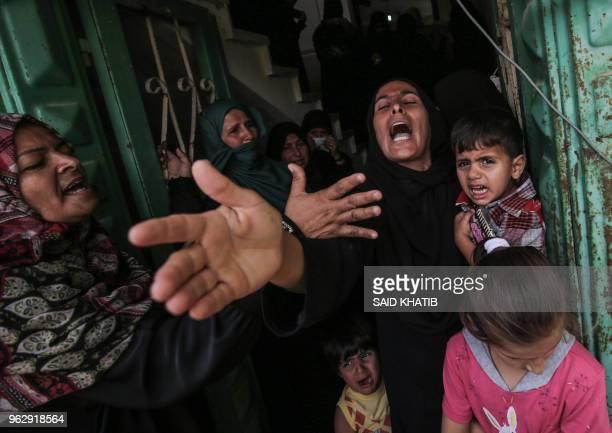 TOPSHOT Palestinian relatives of 28yearold Islamic Jihad member Abdul Haleem alNaqa mourn during his funeral in Khan Yunis in the southern Gaza strip...