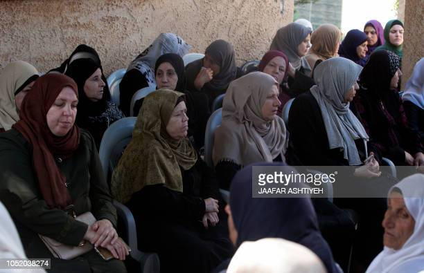 Palestinian relatives of 48yearold mother of eight Aisha Rabi who died of her wounds after the car she was travelling in with her husband was hit by...