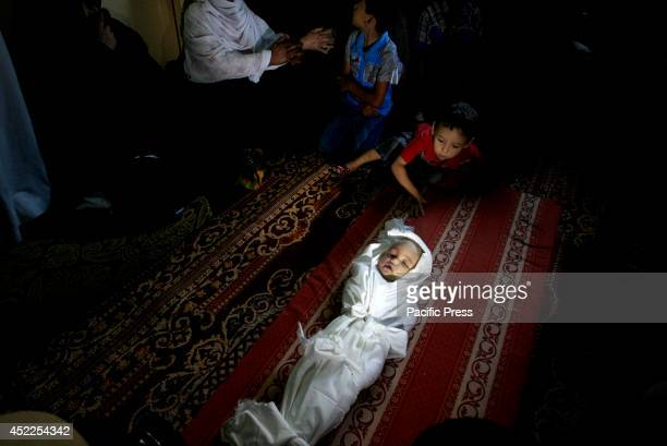 Palestinian relatives of a five-month-old Palestinian child, Lama al-Satary, mourn during his funeral in Rafah, in the southern Gaza Strip ....