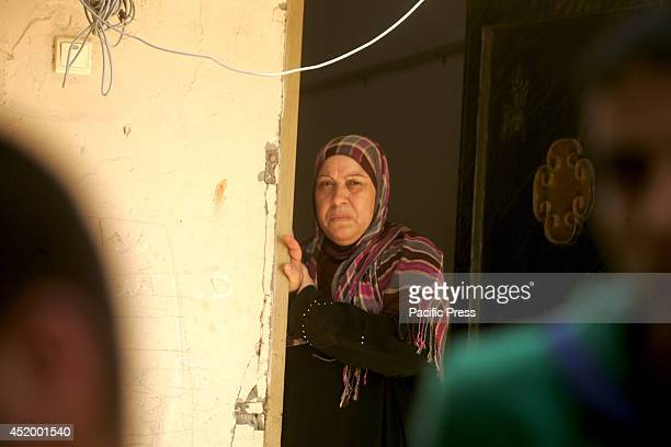 Palestinian relatives of eight members of the Al Haj family who were killed in a strike early morning grieve in the family house during their funeral...